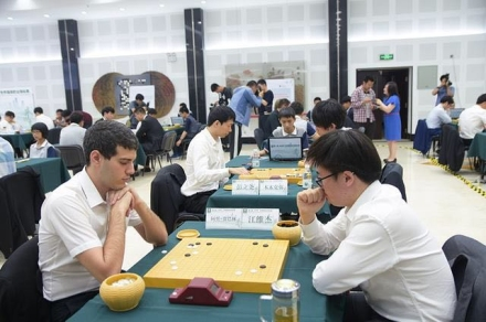 adult playing weiqi